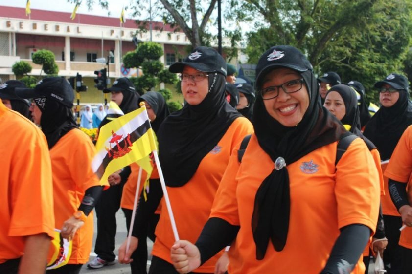Ready for a pose even while marching!